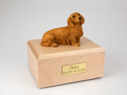 Long-haired brown Dachshund figurine cremation urn w/wood box