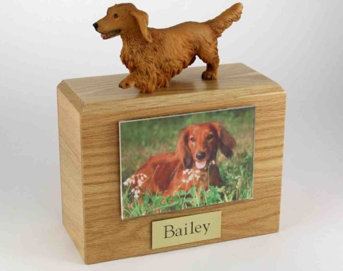 "Wood cremation urn with figurine and 3.5 x 5"" photo holder."