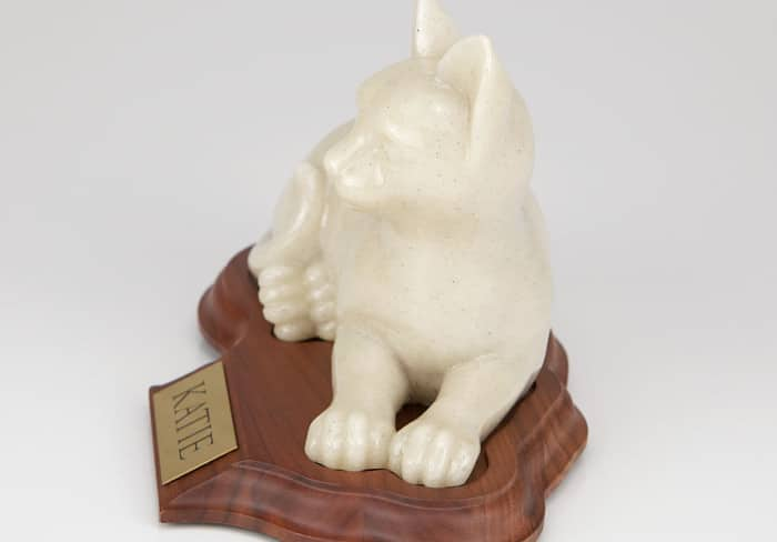 Stone and Resin Porcelain-style Cat Cremation Urn with base, laying