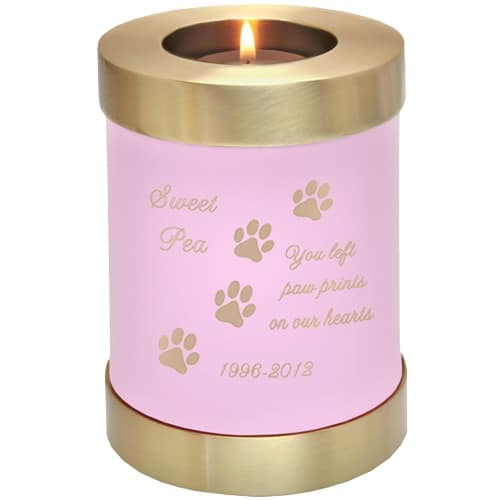 Pink brass candle holder cremation urn, engraved with paw print clip art