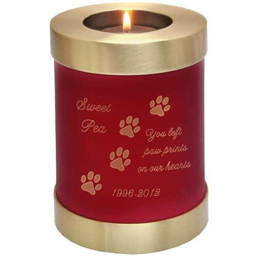 Scarlet brass candle holder cremation urn, engraved with paw print clip art