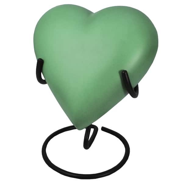 Engraved brass heart cremation urn, sage green, with stand