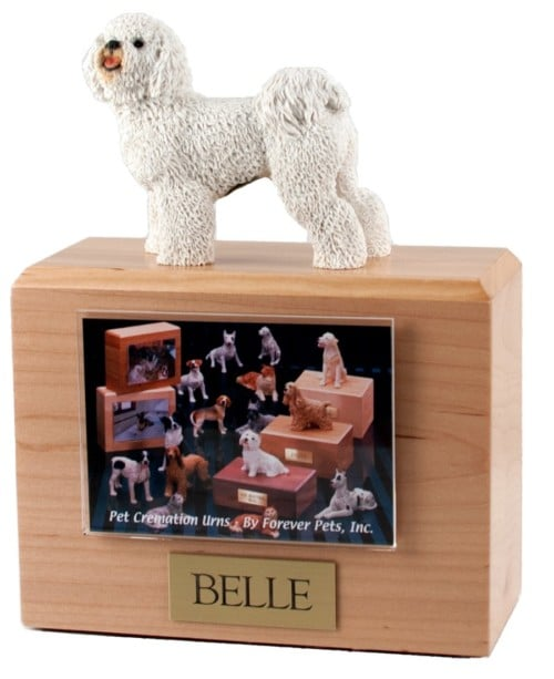 Bichon Frise figurine atop hardwood photo holder dog urn