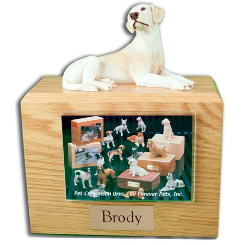 Laying Yellow Labrador Retriever figurine on wood cremation urn with photo holder